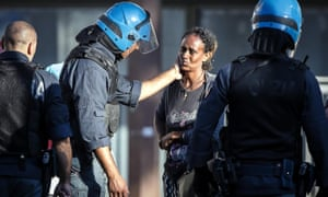 A police officer comforts a woman.