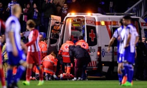 Fernando Torres is carried into an ambulance and taken to hospital after suffering a head injury during Atlético Madrid's 1-1 draw with Deportivo La Coruña on Thursday.