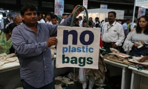 A man displays a jute bag at an exhibition in Mumbai last week to make people aware about the plastics ban