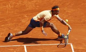 Nadal returns the ball as he fights back.