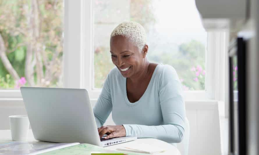 middle aged woman browsing on laptop