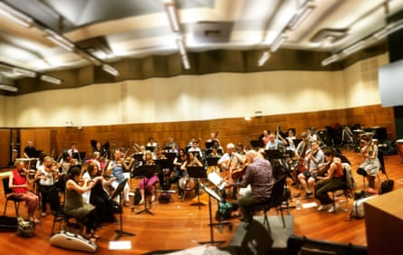 The City of London Sinfonia, directed from the viola by the 'magnetising' Brett Dean, in rehearsals.