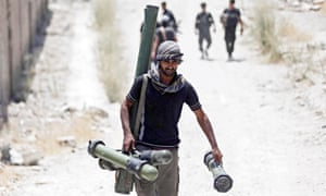 Free Syrian Army fighters approach the frontline against government military forces in Damascus.