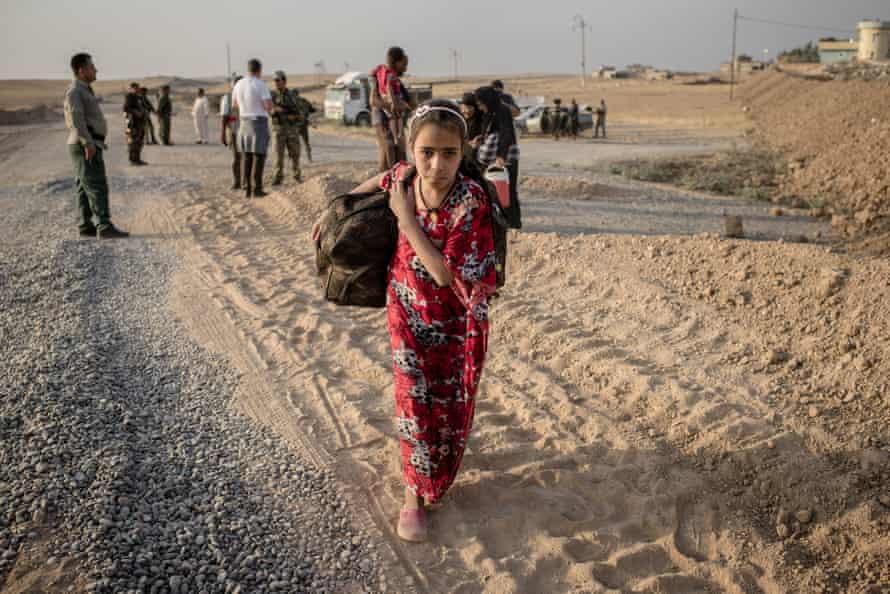 A girl arrives at the Peshmerga frontline.