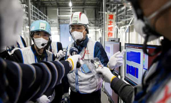 A Tepco employee speaks to the media at the company's Fukushima Daiichi nuclear power plant.