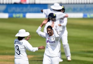 India's Sneh Rana celebrates taking the wicket of England's Tamsin Beaumont.