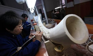 Chinese artists work on ivory sculptures in the Beijing Ivory Carving Factory in Beijing, China