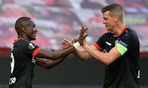 Leverkusen's Moussa Diaby (left) celebrates scoring the opening goal with his teammate Lars Bender.