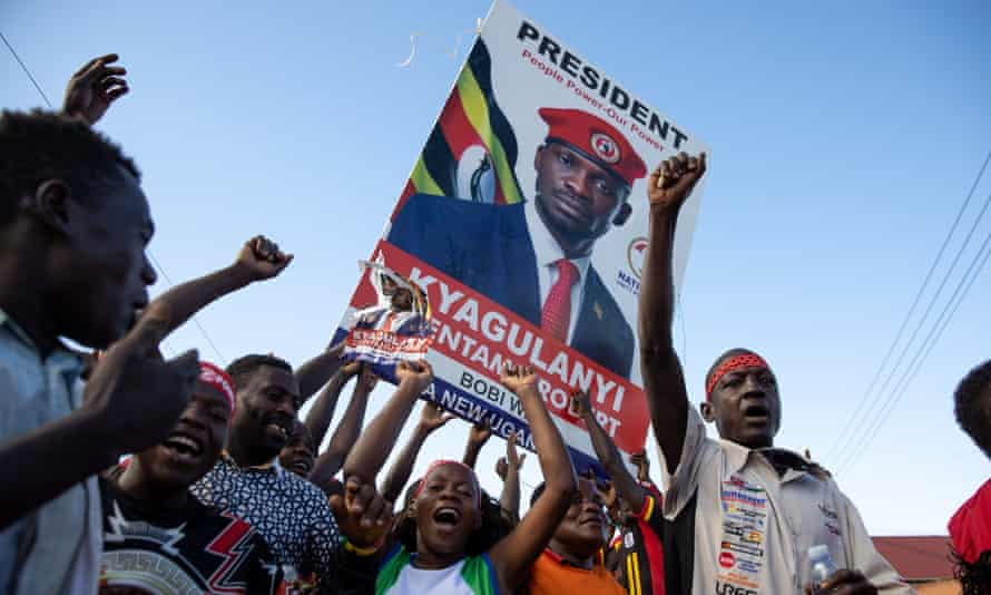 Supporters of Robert Kyagulanyi Ssentamu, otherwise known as Bobi Wine, cheer as he passes through Mukono.