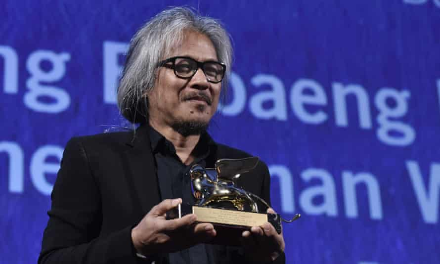 Lav Diaz holds the Golden Lion award for The Woman Who Left.