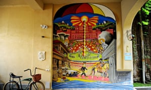 Mural on the outside wall of Umbrella Hostel, Bucharest.