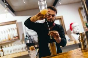 A barman mixes a tipple at Chacha Time, Tbilisi, Georgi.