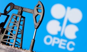 A 3D printed oil pump jack is seen in front of the OPEC logo