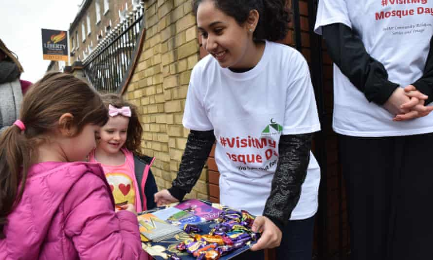 Volunteers hand out sweets and goodie bags to children visiting Finsbury Park mosque.