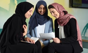 Sara Ziglam (R) shares her results with Ayah Shah (L) and Khansa Iqbal.