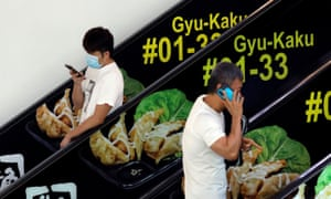People on phones in singapore