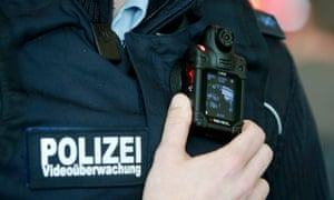 A German federal police officer poses with his video surveillance camera during drill at Ostbahnhof train station in Berlin Ostbahnhof train station in Berlin