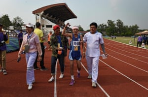 An elderly man in the 90-95 age category celebrating after finishing the 400m sprint