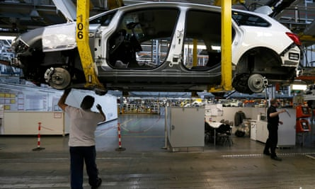 Employees working on the Astra production line at the Vauxhall plant in Ellesmere Port.