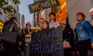 Women protest against Donald Trump outside the president-elect's tower in New York city.