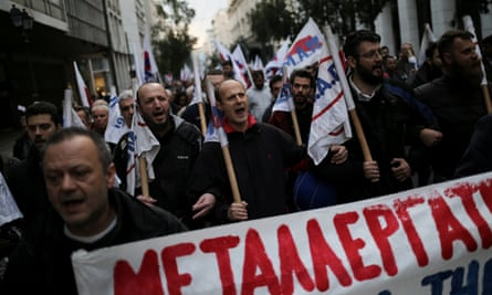Pro-communist protesters march through Athens on Friday.