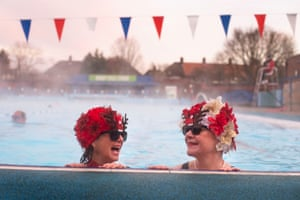 London, UK. Jessica Walker and Nicola Foster, known as the Lido Ladies, swim at Charlton Lido in Hornfair Park, on its first day of reopening after the second national lockdown ended