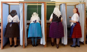 Women dressed in traditional Hungarian outfits prepare their votes in a polling station in a school in Veresegyhaz, some 30kms east of Budapest, on April 8, 2018, during the general election.