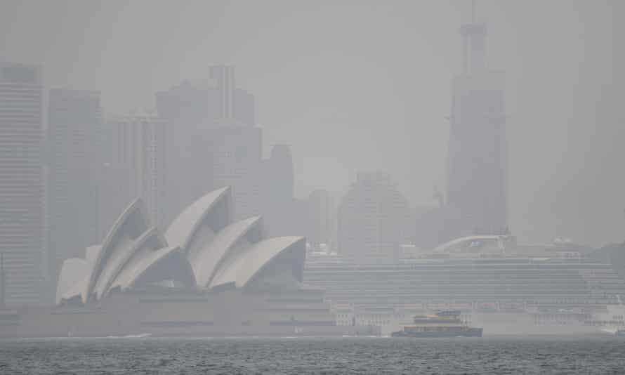 view of harbour and opera house in bushfire haze