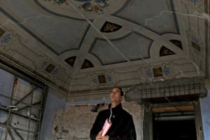 Luca Cucchiella looks at historical frescoes on the ceiling of a room in his family's house in in Santo Stefano. The property is undergoing restoration after being damaged during the 2009 earthquake