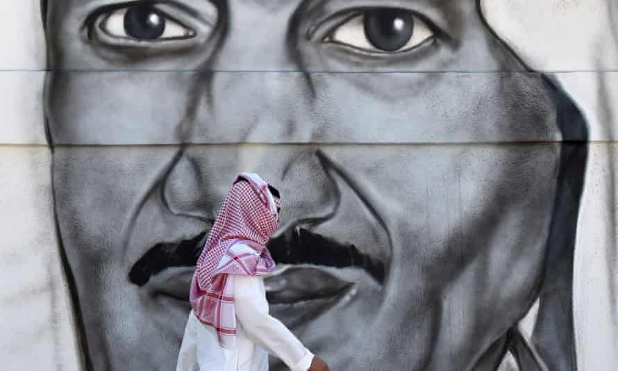 A man walks past a mural of King Salman in the capital Riyadh.