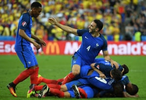 Anthony Martial celebrates with the French players after Payet's stunning goal.