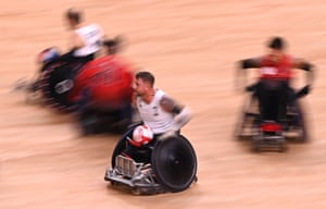 Stuart Robinson of team GB makes a break to score a try during the Wheelchair Rugby match against Canada.