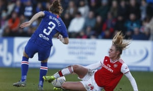 Hannah Blundell of Chelsea and Jill Roord of Arsenal during a Barclays women's super league match at Meadow Park Stadium, Borehamwood.