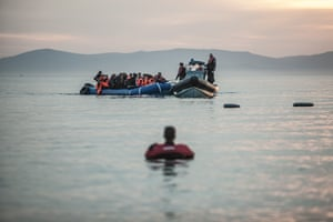 A boat carrying refugees arrives on the small Greek island of Lesbos
