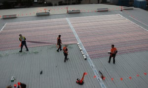 Organic printed solar cells on sub-millimetre thin plastic sheets being installed at the pilot project