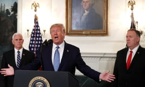Donald Trump is flanked by Vice-President Mike Pence, left and the secretary of state, Mike Pompeo, while announcing the lifting of sanctions on Turkey at the White House on Wednesday.
