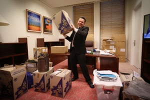 South Australian senator Nick Xenophon horses around for the camera with his boxes in his office in Parliament House in Canberra this evening.