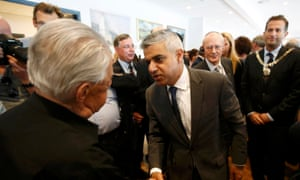 London's newly elected mayor Sadiq Khan meets holocaust survivor Harry Fleming at a holocaust commemoration ceremony held at a rugby stadium in north London