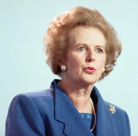 Thatcher in a blue jacket