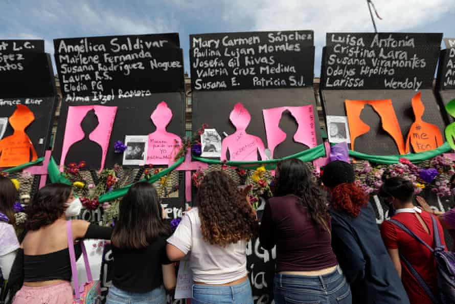Women protest outside the National Palace in Mexico City on International Women's Day.