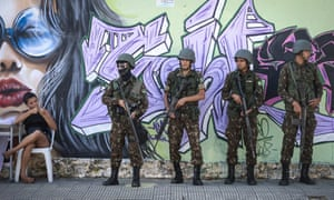 Brazilian soldiers stand guard at a polling station in Fortaleza, Brazil, on Sunday.