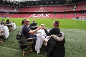 Guests dine at a pop-up restaurant pitchside at the Johan Cruijff Arena, in Amsterdam, the Netherlands.