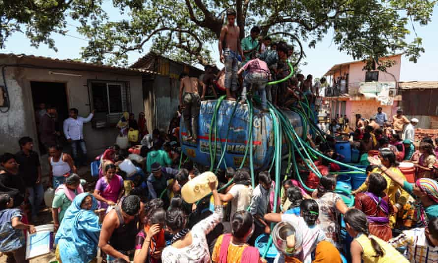 People collect water from a tanker in Bhiwandi, on the outskirts of Mumbai.