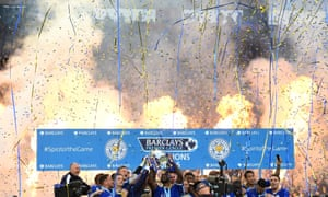 Captain Wes Morgan and manager Claudio Ranieri of Leicester City lift the Premier League Trophy as players and staff celebrate,