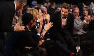 Richard Madden rises to pick up his award at London's O2.
