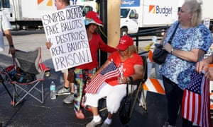 Protesters sit outside Broward county election offices during a ballot recount in Lauderhill, Florida.