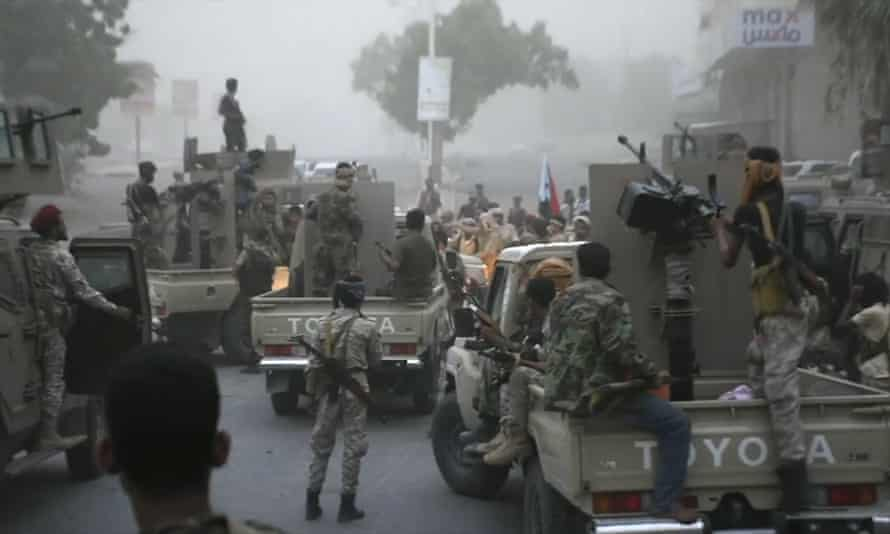 Separatist fighters, backed by the UAE, line up to storm the presidential palace in the southern port city of Aden.