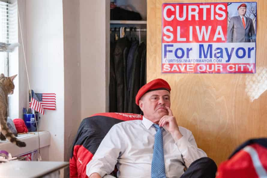 Sliwa in front of his mayoral sign.