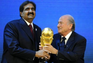 Sepp Blatter (right) gives the World Cup trophy to Sheikh Hamad bin Khalifa Al-Thani, Emir of Qatar, after Qatar was announced as host of the 2022 World Cup in December 2010.