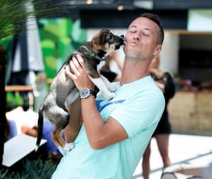 Philipp Kohlschreiber meets a seven-week-old puppy from Second Chance Rescue